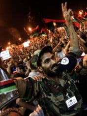 Rebels in their thousands flooded Tripoli's Green Square in a show of power
