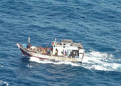 navy fires shots at asylum seekers