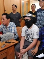 The Bali boy was paraded in front of the media wearing a makeshift disguise