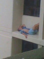 The photo of Cameron lying on the balcony