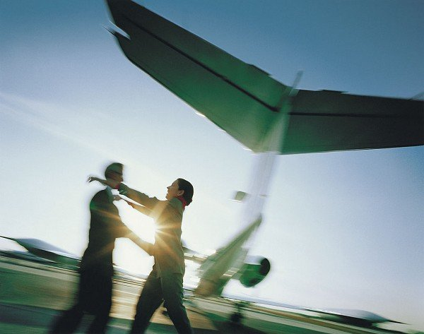 You could be just like this couple embracing on a tarmac. Very unsafe, but romantic.