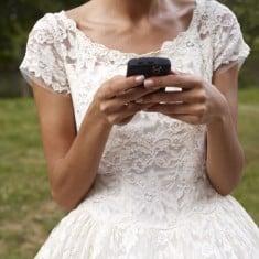 bride checks her phone