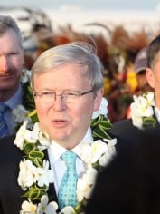 Kevin Rudd has arrived in PNG to try and find a solution for the large numbers of boat people, another potent Abbott attack point.