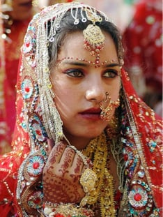 A young woman looks concerned on her wedding day.