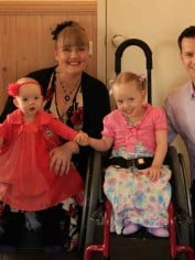 5-year-old Jessica has spina bifida. Here she is with her family.