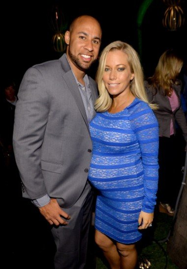 Hank Baskett (L) and Kendra Wilkinson earlier this year. (Photo: Michael Buckner/Getty Images.)