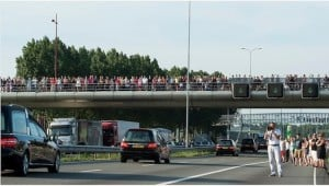 Crowds pay respect for the dead as they arrive in The Netherlands