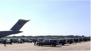 Hearses await the coffins to be unloaded from the plane