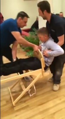 Man stuck in high chair