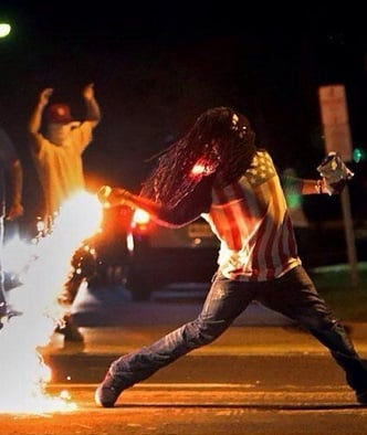 throwing tear gas in ferguson