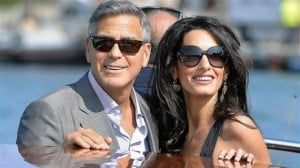 George Clooney and Amal Alamuddin arrive in Venice. Via: Getty Images