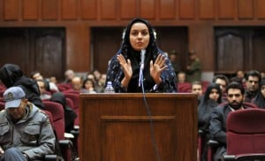A picture taken on December 15, 2008 at a court in Tehran shows Iranian Reyhaneh Jabbari speaking to defend herself during the first hearing of her trial for the murder of a former intelligence official. Jabbari who is awaiting an impending death sentence for slaying of former intelligence official Morteza Abdolali Sarbandi, could be forgiven if 'she tells the truth', the victim's son said on April 19, 2014 as a UN human rights monitor claims the crime was done in self-defence against a potential rapist. (image vi Getty).