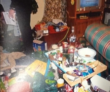 The living room was deep with rubbish.