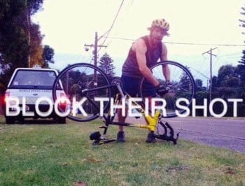 A cyclist blocks the shot of a speed camera