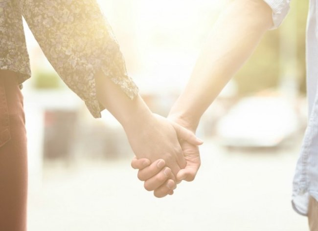 Couple holding hands lead resize
