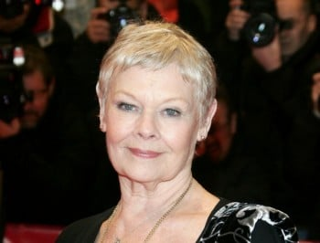 Dame Judi Dench gets butt tattoo, remains bad-ass at 80.