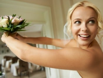 A gorgeous bride prepares to throw her bouquet