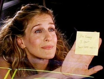 Berger from Sex and the City poses with THAT break up note.