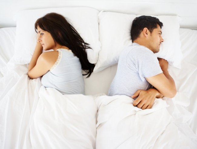 couple disagree in bed
