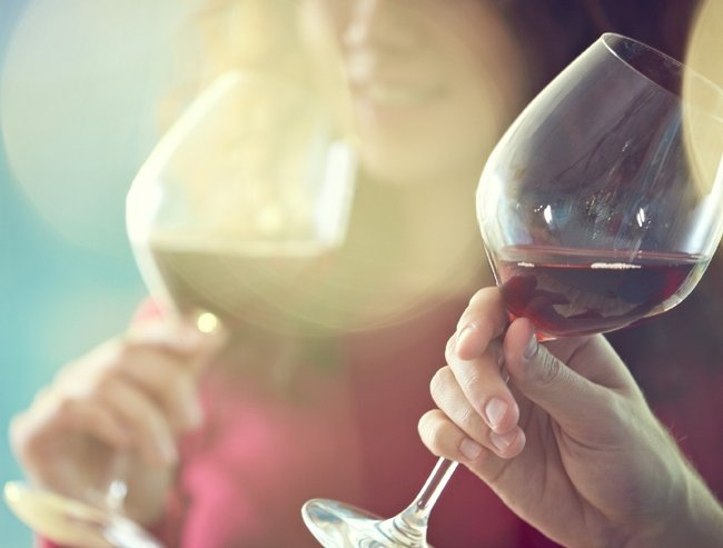 Close-up of people tasting red wine in glass