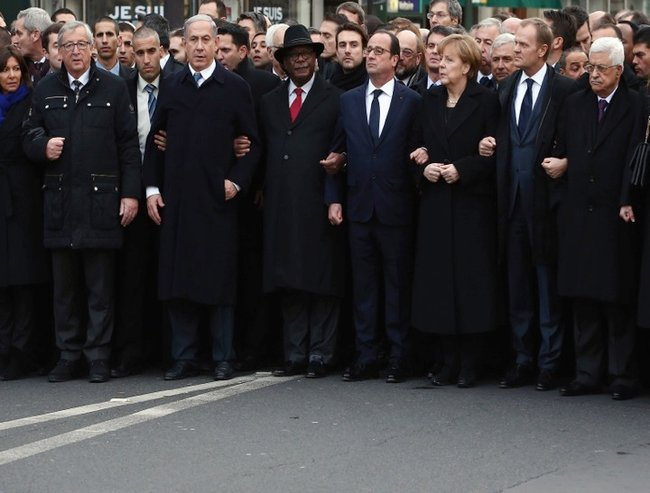 The world leaders marched arm in arm.