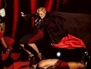 Walk it off, Madge: Madonna stacks it on stage at the Brit Awards.