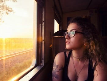 girl looking oiut train window tattoos