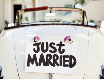 """Just Married"" Sign Attached On Car's Trunk"
