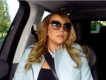 Mariah Carey sings karaoke in the car. To her own songs. Gold.