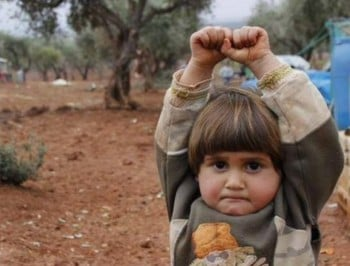"The Syrian child who thought the camera was a gun - and ""surrendered""."
