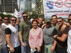 They're entrusted with protecting asylum seekers. And they posed alongside Pauline Hanson at a 'Reclaim Australia' rally.