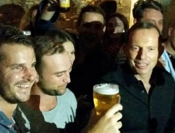 The crowd says SKOL!: Tony Abbott drinks a full glass of beer.