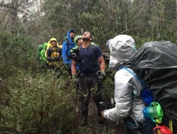 Charity walk on Overland Track a success for father who carried son with cerebral palsy for a week.
