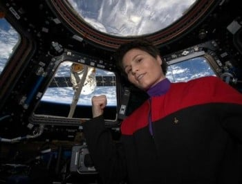 Hero of the geeks: Female astronaut wears Star Trek costume in space.