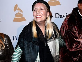 Joni Mitchell rushed to hospital after being found unconcious at home.