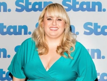Rebel Wilson walks the red carpet with her new partner.