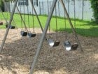 Mother found pushing dead son on a swing.