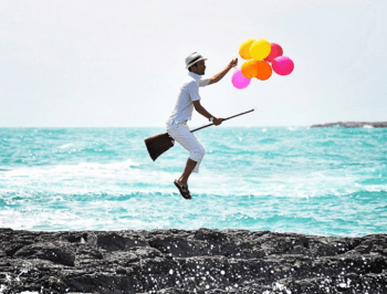 Voulez-Vous: A man. A broomstick. A bunch of balloons. And some serious photoshop.