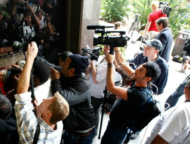 Actress Lindsay Lohan arrives at the Beverly Hills Courthouse to surrender to serve her 90 day jail sentence on July 20, 2010 in Beverly Hills, California. Lindsay Lohan was found in violation of her probation for the August 2007 no-contest plea to drug and alcohol charges stemming from two separate traffic accidents.