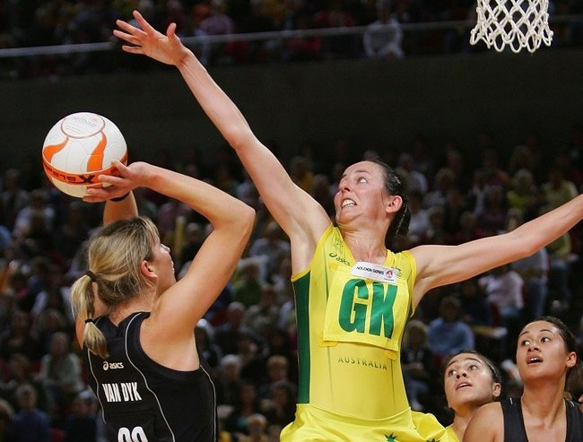 SYDNEY - JULY 25:  Liz Ellis of Australia tries to block a shot for goal from Irene van Dyk of New Zealand during the second netball test between Australia and New Zealand held at the Acer Arena, Sydney Olympic Park on July 25, 2006 in Sydney, Australia.  (Photo by Chris McGrath/Getty Images)