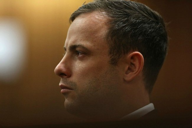 BY COURT ORDER, THIS IMAGE IS FREE TO USE.  PRETORIA, SOUTH AFRICA - SEPTEMBER 12:  (SOUTH AFRICA OUT) Oscar Pistorius at the Pretoria High Court on September 12, 2014, in Pretoria, South Africa. Pistorius, stands accused of the murder of his girlfriend, Reeva Steenkamp, on February 14, 2013. This is his' official trial, the result of which will determine the paralympian athlete's fate. Judge Masipa continues to deliver her verdict. (Photo by Alon Skuy/The Times/Gallo Image/Getty Images)