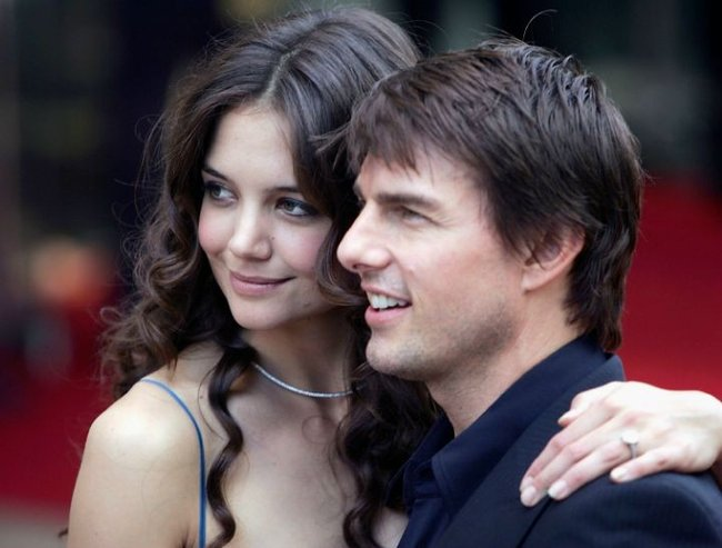 """LONDON - JUNE 19:  Actor Tom Cruise and actress Katie Holmes arrive for the UK Premiere of his new blockbuster """"War Of The Worlds"""" at the Odeon Leicester Square on June 19, 2005 in London, England.  (Photo by MJ Kim/Getty Images) *** Local Caption *** Tom Cruise;Katie Holmes"""