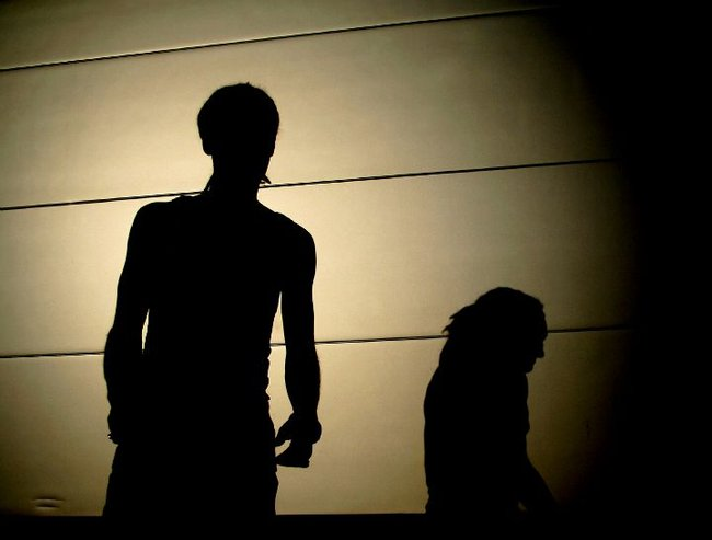 man shadows child abuse feature