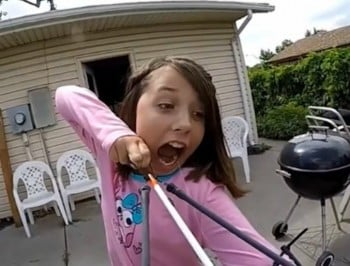 Watch as a little girl removes her wobbly tooth with a sling-bow.