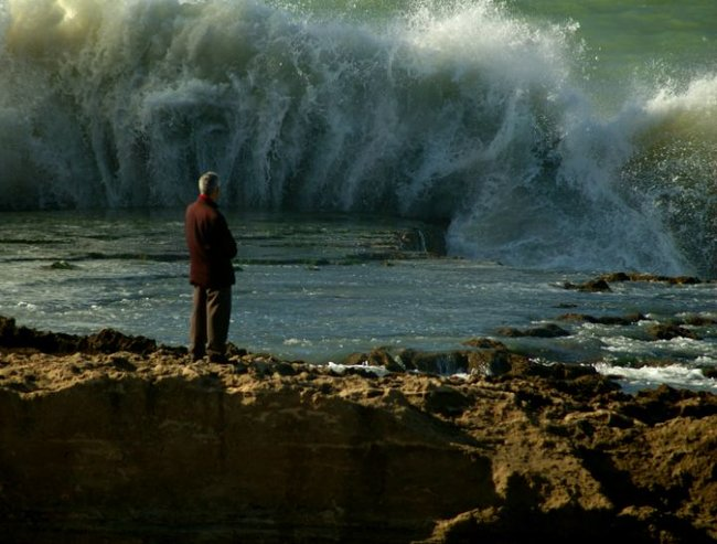 Waves crashing old man