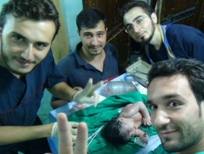 Mother and her Syrian baby saved by doctors in dramatic video