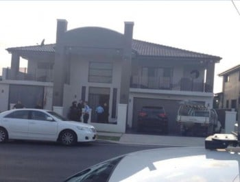 Five people arrested as police raid properties across western Sydney.