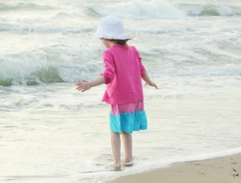 Little girl at the beach feature
