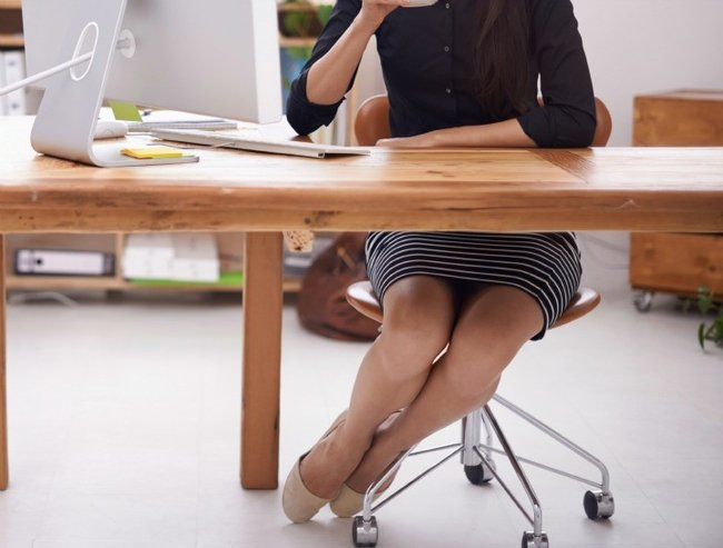 Full length portrait of a young businesswoman working at her desk