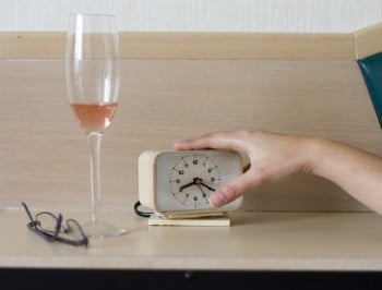 Woman's hand trying to turn the alarm off
